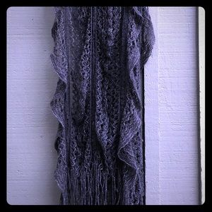 Very long sparkly gray scarf.